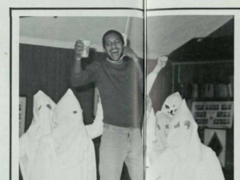 "A photo of Michael Kizzie, '81, in the 1980 University of Richmond yearbook. An excerpt on the same page read ""Kizzie 'hangs' around lodge."""