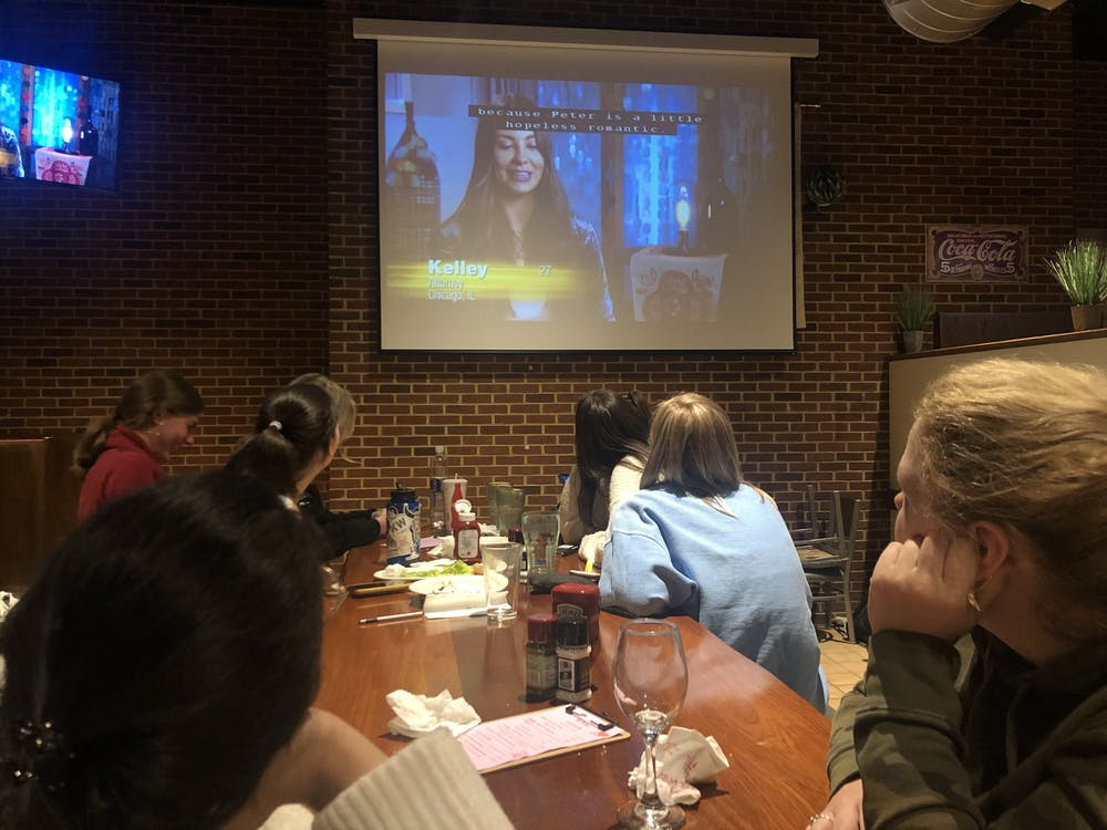 "Students watch an episode of ""The Bachelor,"" a popular reality television show. The Cellar, UR's on-campus restaurant, is now hosting ""Bachelor Mondays,"" showing the episodes as they air each week, starting at 8 p.m."