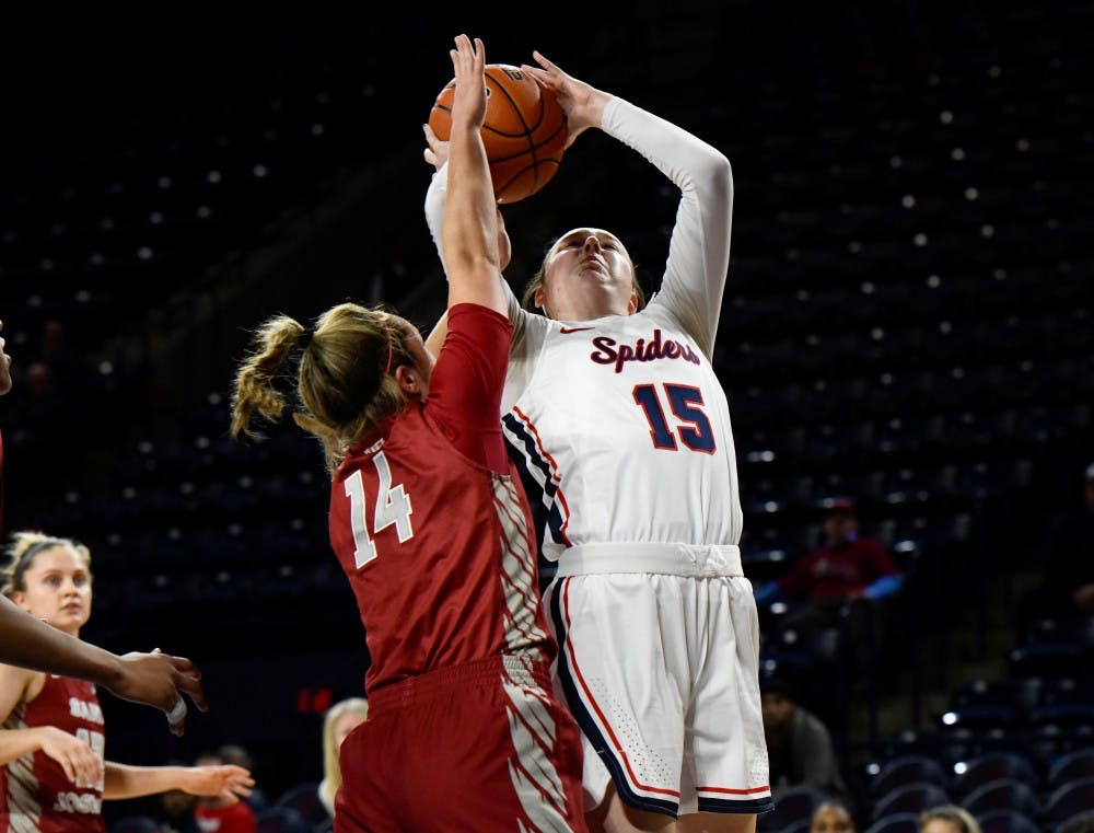 <p>First-year forward Emma Squires takes a shot at a Wednesday night game against Saint Joseph's University.</p>