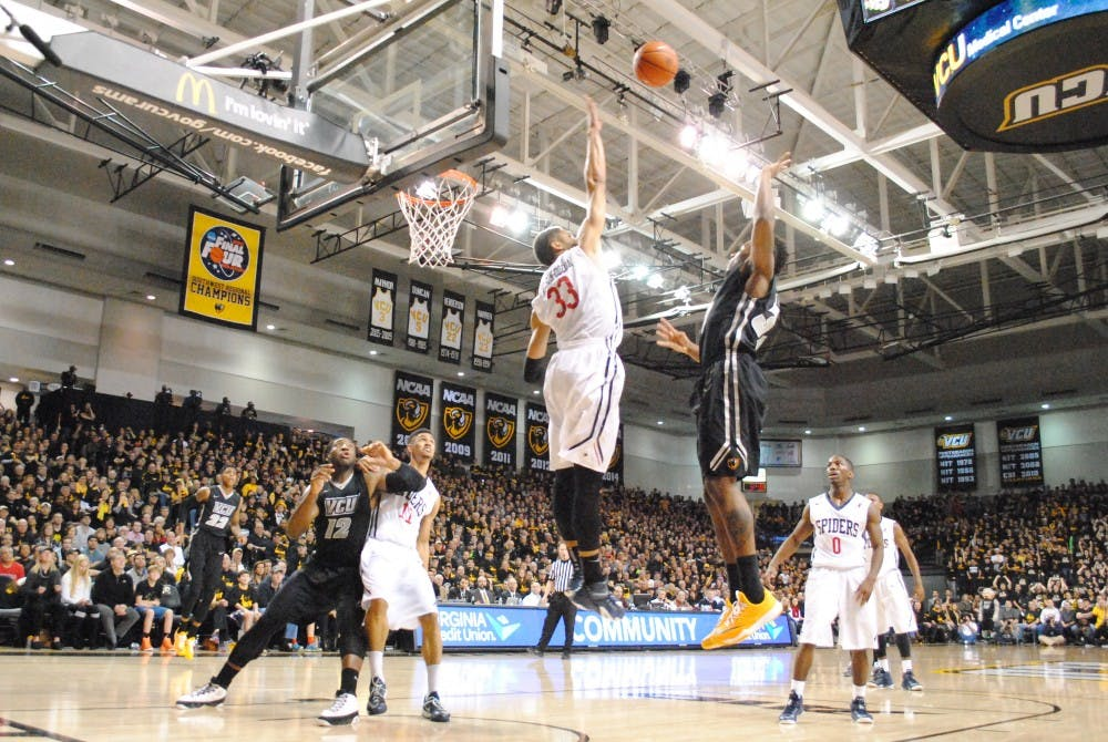<p>Alonzo Nelson-Odada attempts to block a shot during the Spider's 64-55 upset over VCU.</p>