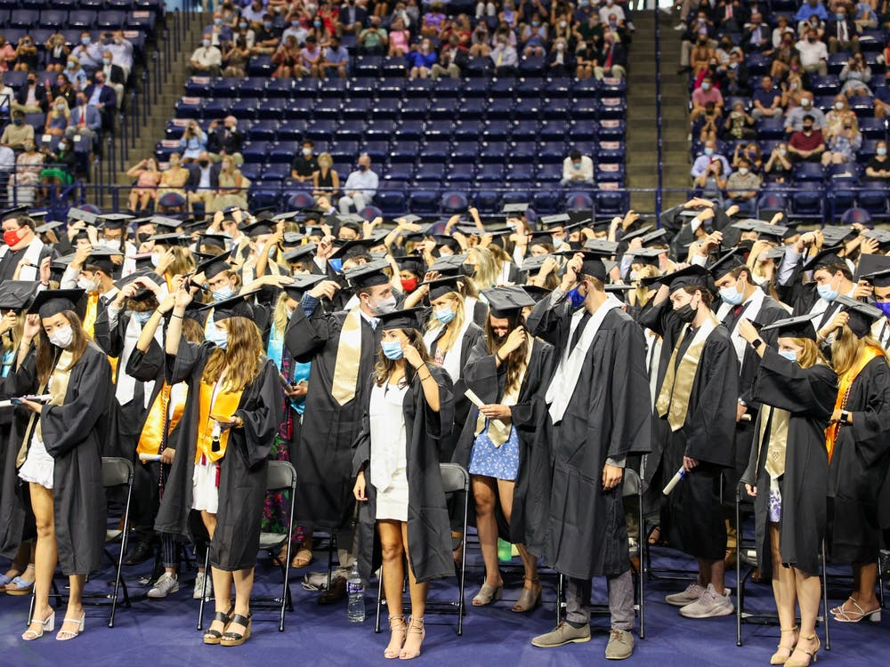 Graduates from the class of 2020 move their tassels from the right to the left side of their caps to signify their graduation.