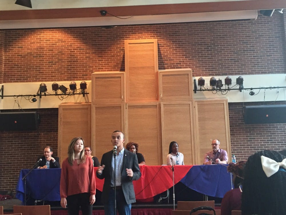 <p>Mia Hagerty, WC '17, and Ken Anderson, RC '17,&nbsp; the current WCGA and RCSGA presidents,&nbsp;introduce the panelists before the forum on race and racism begins.&nbsp;</p>