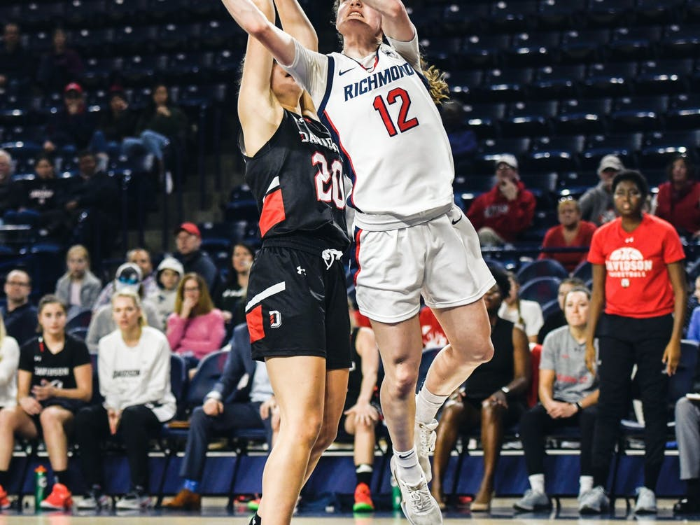 Sophomore guard Claire Holt makes a shot past Davidson defense during a game at the Robins Center on Sunday, Jan. 26, 2020.