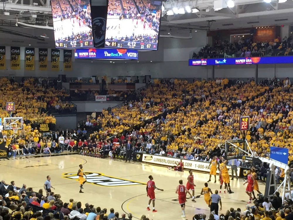 The Siegel Center was full of gold as the VCU Rams dunked all over the Spiders Friday night.