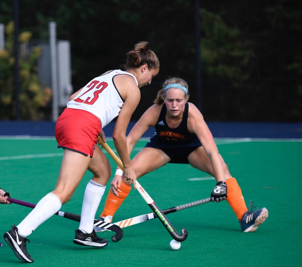 <p>First-year midfielder Lindsey Frank avoids Bucknell University defense during Sunday's game.&nbsp;</p>