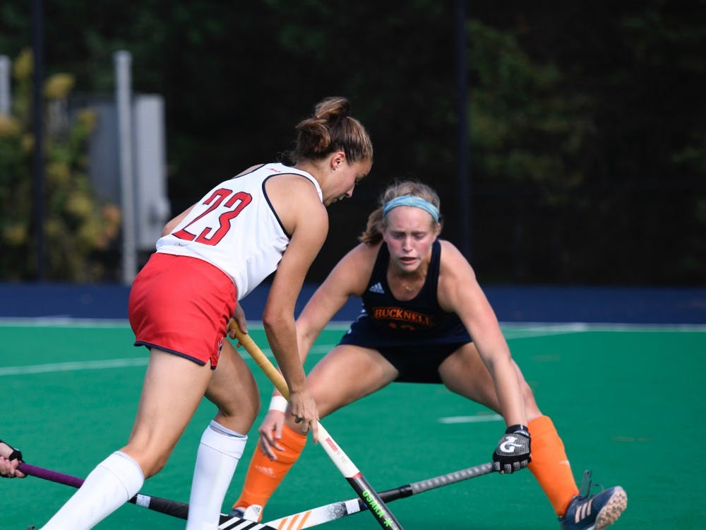 First-year midfielder Lindsey Frank avoids Bucknell University defense during Sunday's game.
