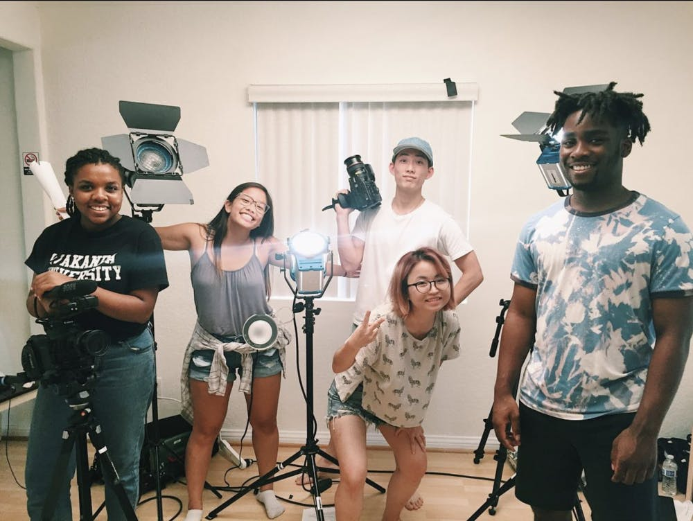 <p>Senior Jeanette Lam (second from left) with her production team this past summer working for the Jubilee media video series. <em>Courtesy of Jeanette Lam.</em></p>