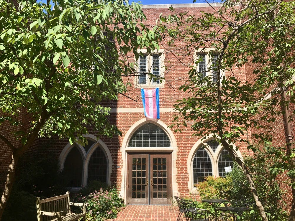 A transgender pride flag hung over an entrance to the T. C. Williams School of Law.