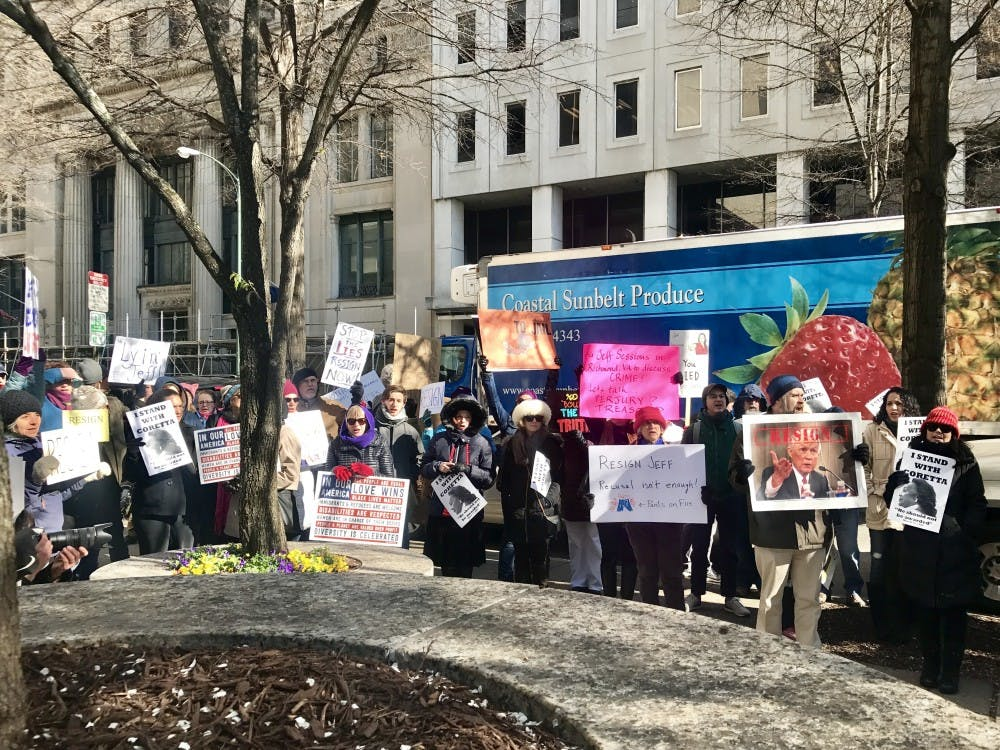 Protesters voiced concern over why Sessions had not chosen to have Wednesday's meeting open to the public. Eventually, the crowd began marching laps around the block.