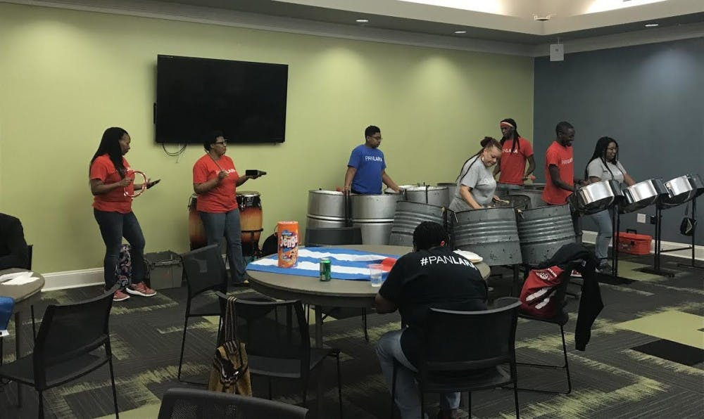 <p>PanLara plays the steel pans at West Indian Lynk's Limin' Out event.</p>