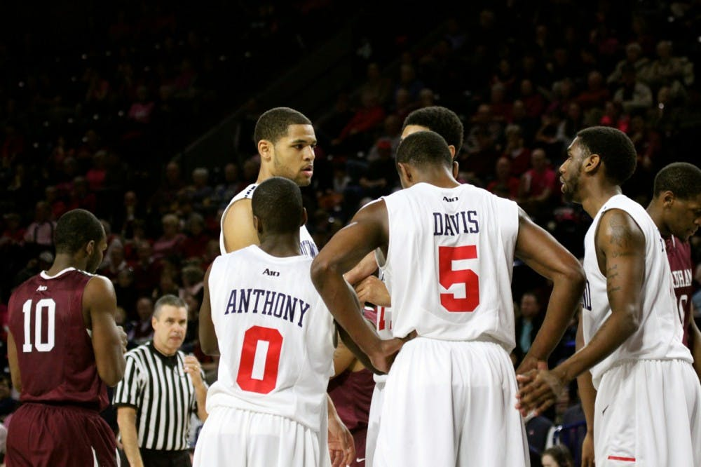 <p>Members or the Richmond Spiders basketball team huddle up during a game against Fordham last season.</p>