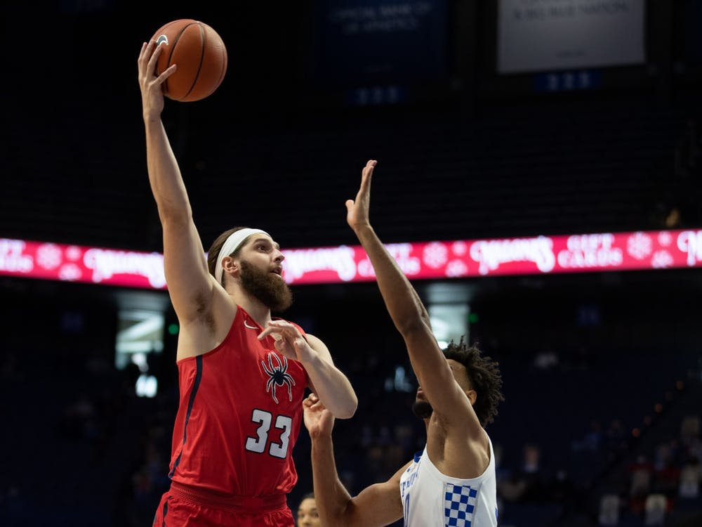 Graduate student forward Grant Golden takes a shot over a defender during a game against Kentucky on Nov. 29 at Rupp Arena in Lexington, Kentucky. Courtesy of Mark Cornelison via SEC Media Portal