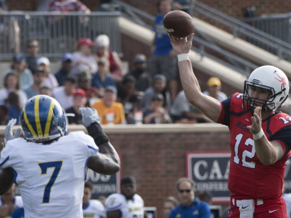 Redshirt sophomore quarterback Joe Mancuso throws a pass in Saturday's loss to Delaware at Robins Stadium. Mancuso set a school record with 560 total yards.