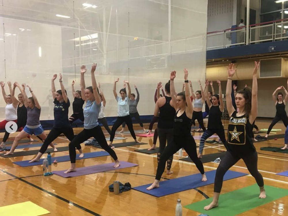 Members of the UR chapter of CHAARG participate in a group yoga class taught by Lunge Yoga in the Weinstein Center for Recreation and Wellness. Photo courtesy of the CHAARG Instagram.