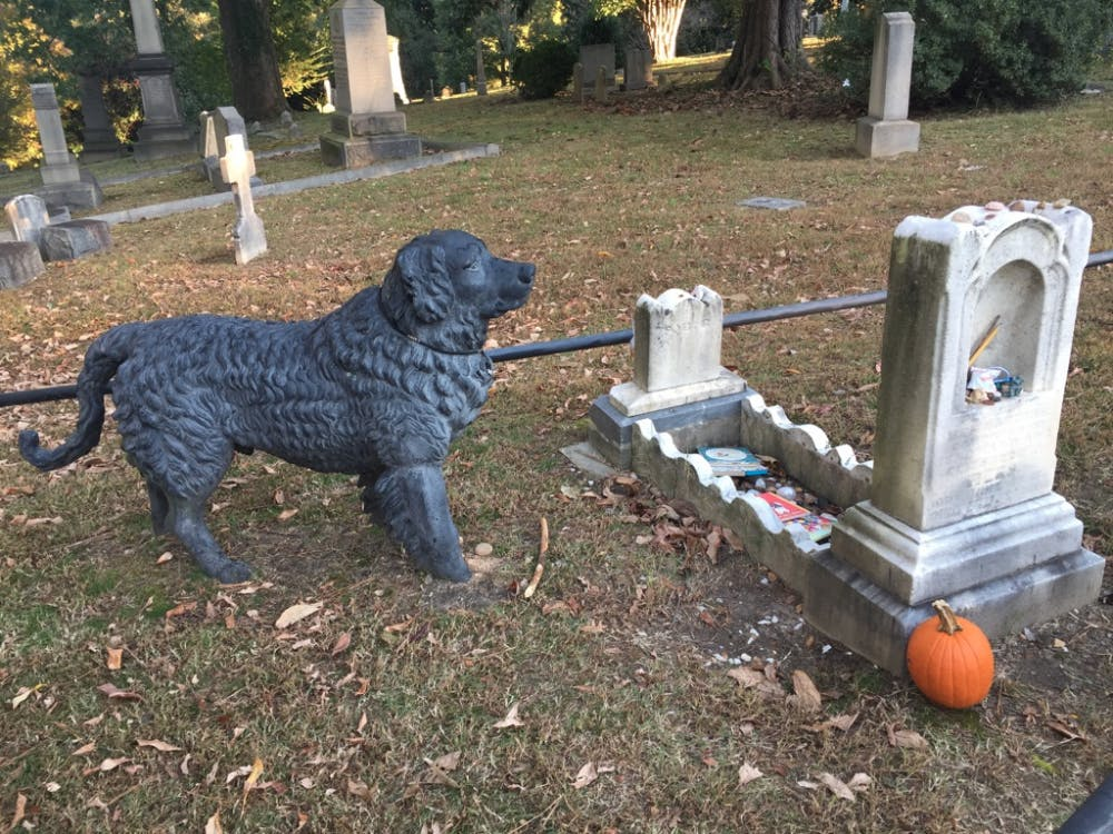 A cast-iron Newfoundland dog stands guard over the grave of a toddler who died in 1862 at the Hollywood Cemetery in Richmond.