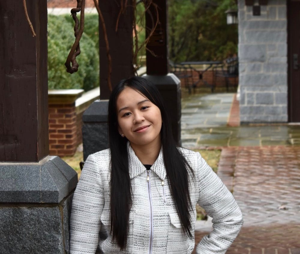 <p>Anya Dinh, co-establisher of Girl UP* UR, poses in front of the Westhampton Deanery.</p>