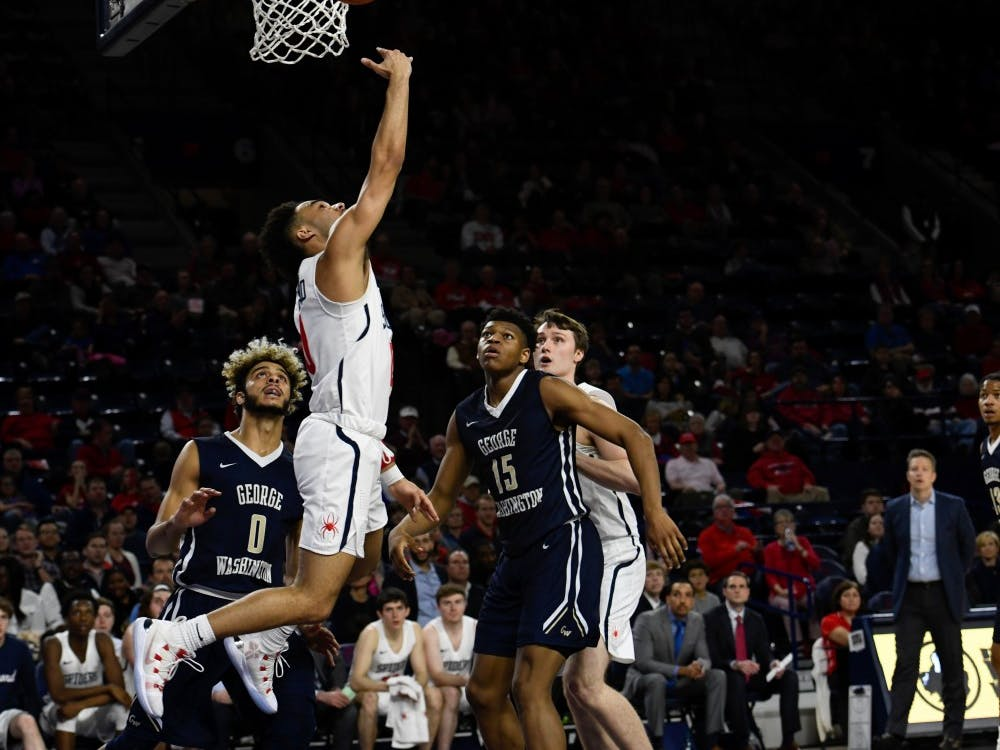 Sophomore guard Jacob Gilyard shoots a layup in a Spider victory over George Washington Saturday night.