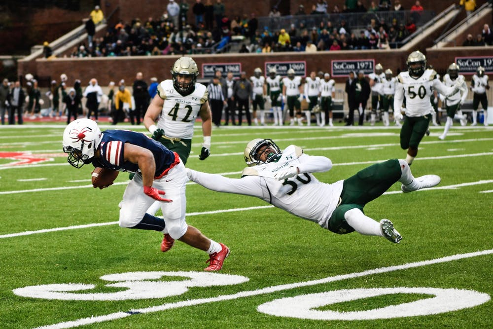 <p>First-year running back Savon Smith evades William and Mary defense during the Capital Cup game on Saturday, November 23, 2019.&nbsp;</p>