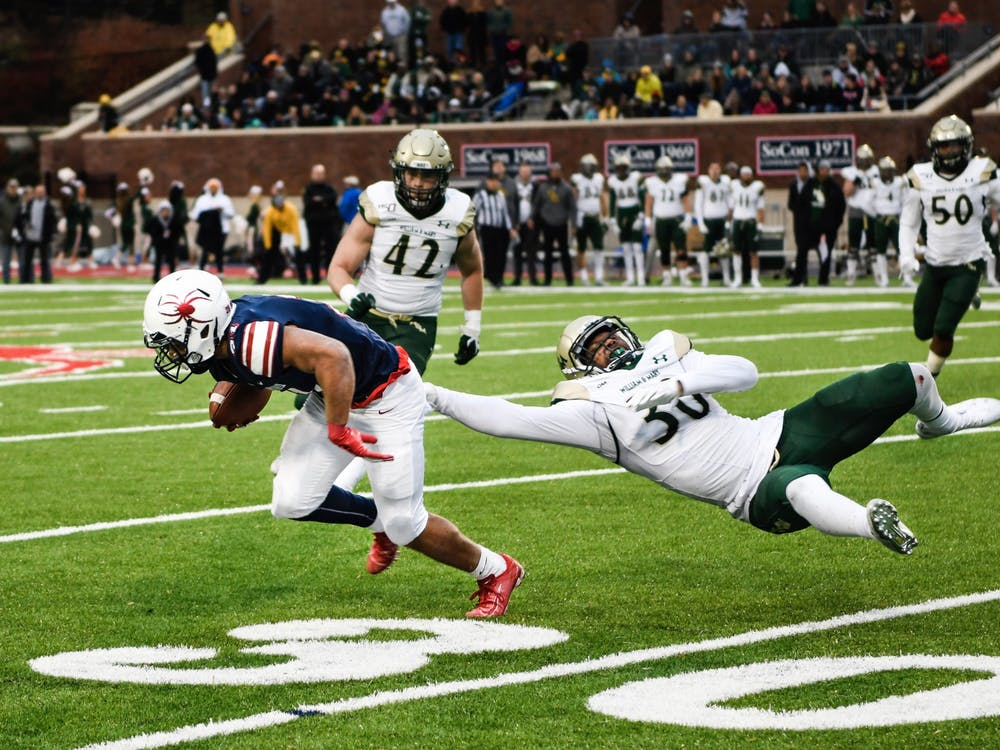 First-year running back Savon Smith evades William and Mary defense during the Capital Cup game on Saturday, November 23, 2019.