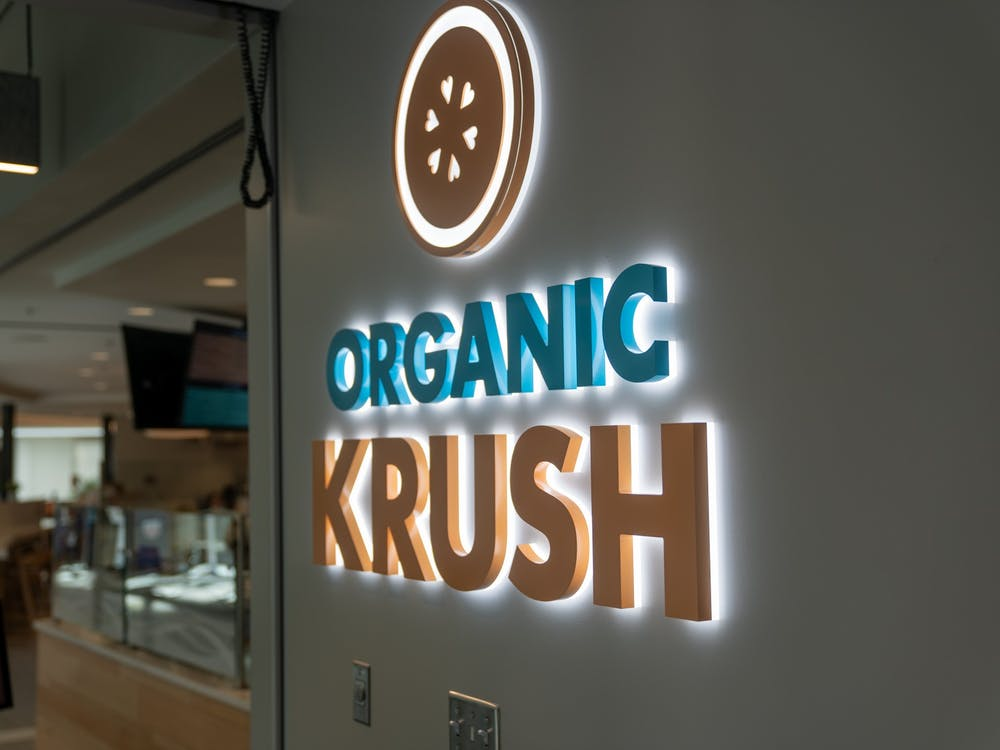 The sign to Organic Krush in the Well-Being Center.