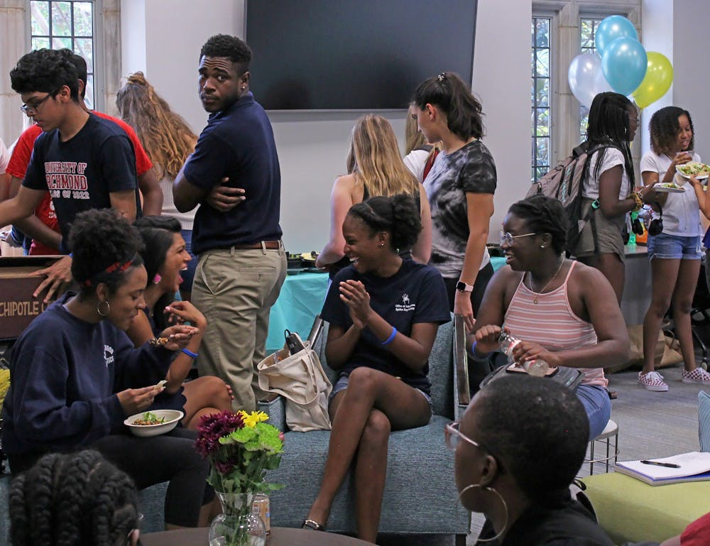 "<p>Students, faculty and staff gather in the new Multicultural Space to celebrate the grand opening of ""The Space.""&nbsp;</p>"