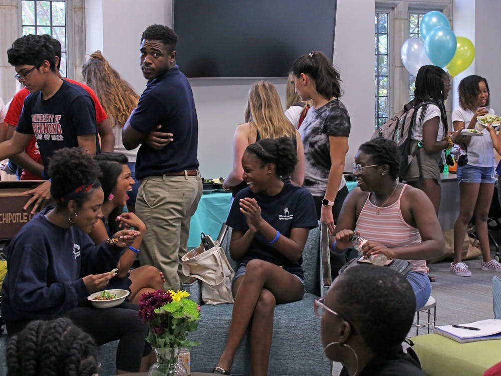"Students, faculty and staff gather in the new Multicultural Space to celebrate the grand opening of ""The Space."""