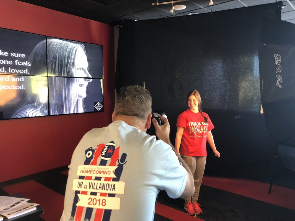 <p>Photographer John Noltner takes a sophomore Jenny Kramer's portrait for his A Peace of Mind project on campus.&nbsp;</p>