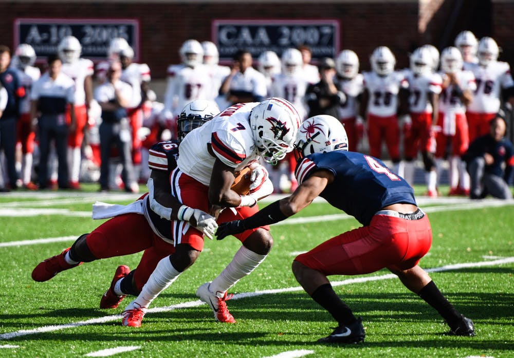 <p>Defensive back Brandon Feamster, a graduate student, goes head-to-head with a player from the Stony Brook University Seawolves during the Homecoming game on Saturday Nov. 2, 2019. The Spiders defeated the Seawolves 30-10. &nbsp;</p>