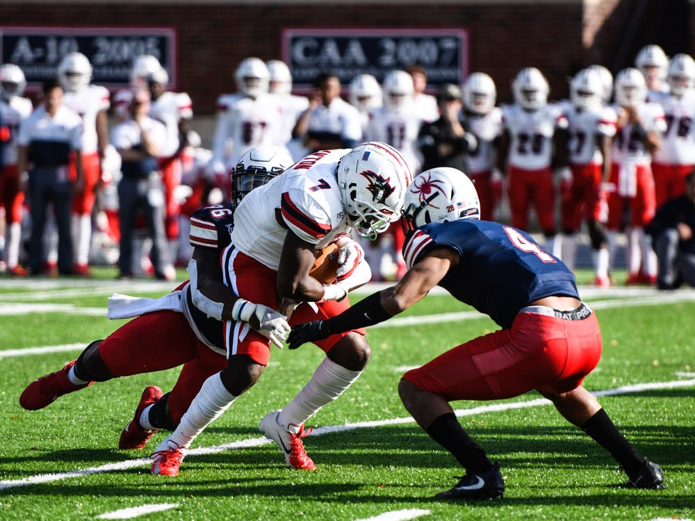 Defensive back Brandon Feamster, a graduate student, goes head-to-head with a player from the Stony Brook University Seawolves during the Homecoming game on Saturday Nov. 2, 2019. The Spiders defeated the Seawolves 30-10.