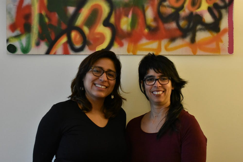 <p>Professors Patricia Herrera (left) and Alicia Díaz pose for a portrait.&nbsp;</p>