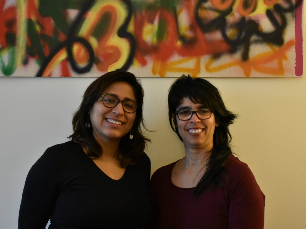 Professors Patricia Herrera (left) and Alicia Díaz pose for a portrait.