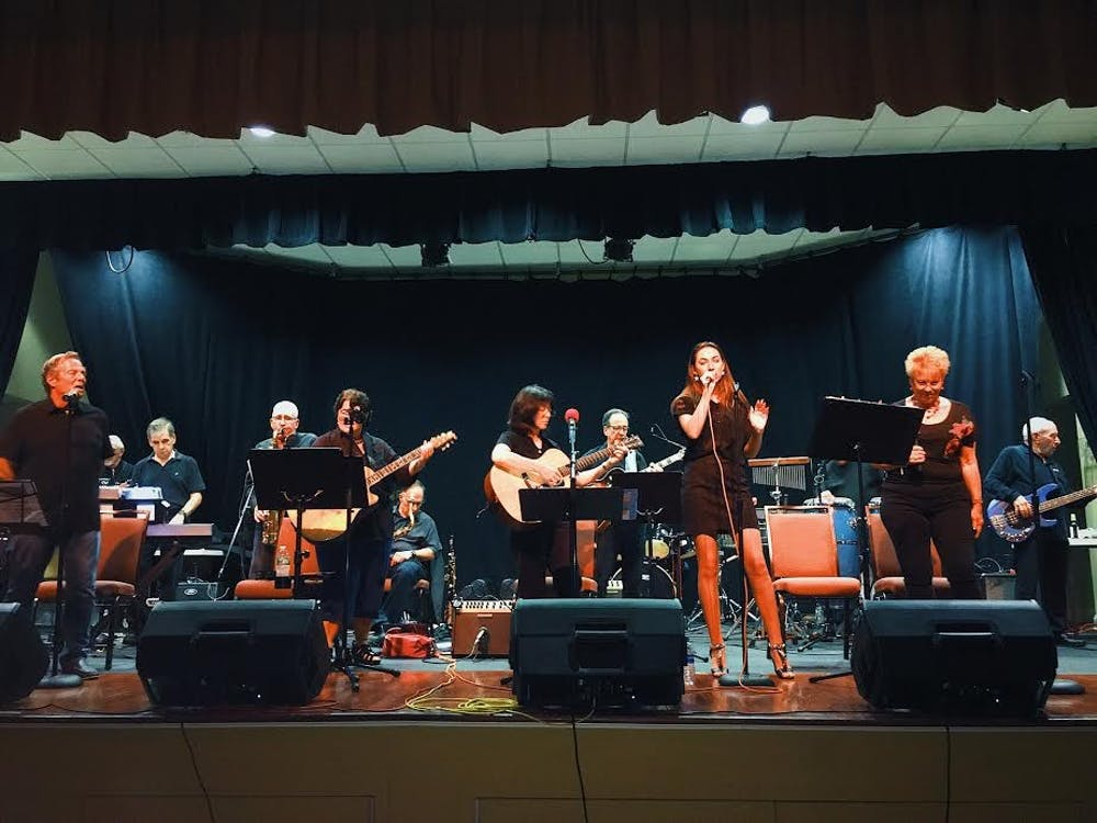 <p>Sophomore Kayla Saltzman singing at Stonebridge Clubhouse in Monroe Township, New Jersey, in July 2018.<em> Photo courtesy of Kayla Saltzman.&nbsp;</em></p>