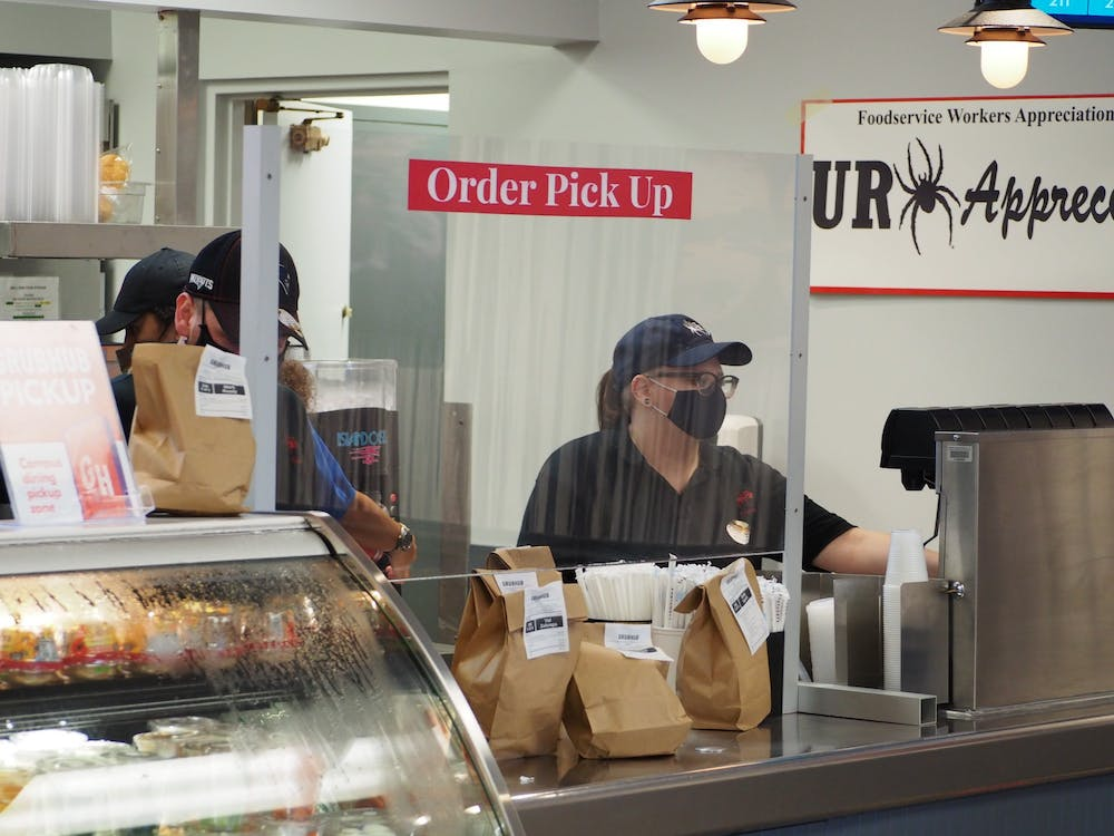 Online food orders accumulate on the counter of Tyler's Grill.