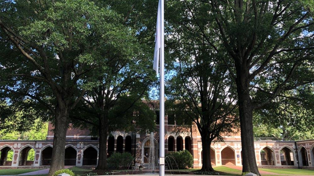 The University of Richmond flag flies at half-staff.