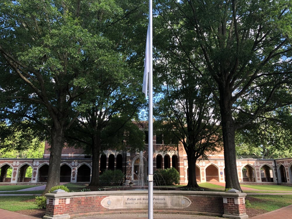 The University of Richmond flag flies at half-staff.