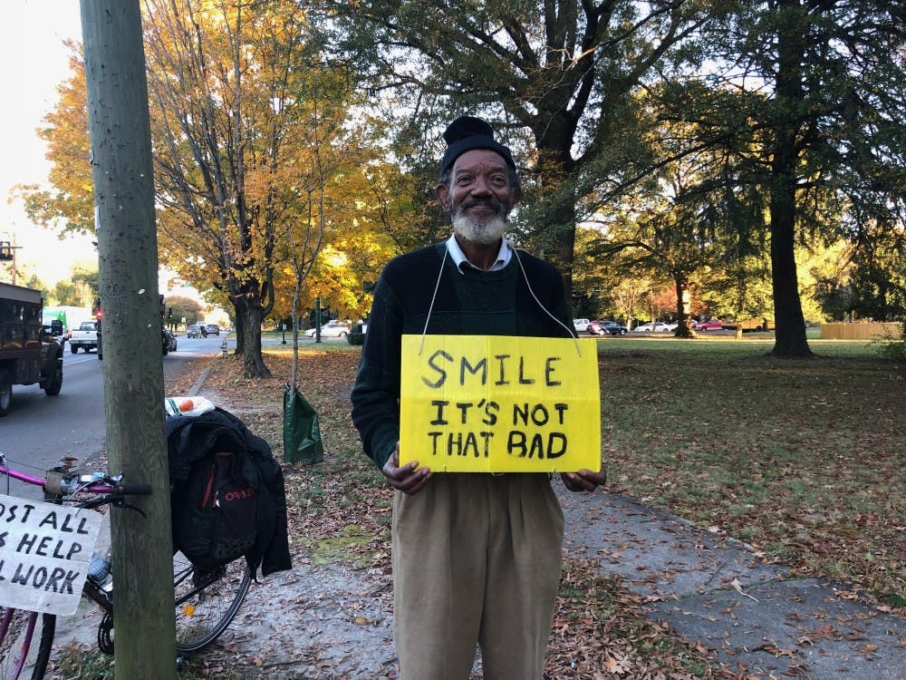 John holds this sign outside on the corner of West Laburnum Avenue and Brook Road for about nine hours every day.