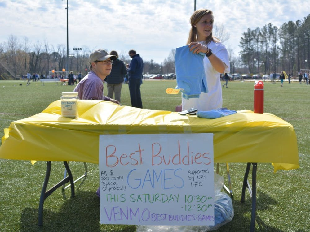 Juniors Tyler Deen and Julia Selman sell Best Buddies t-shirts on the IM fields.