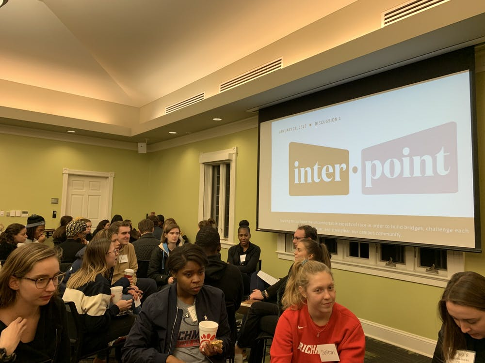 <p>Small groups participate in a facilitated discussion on race at Interpoint.</p>