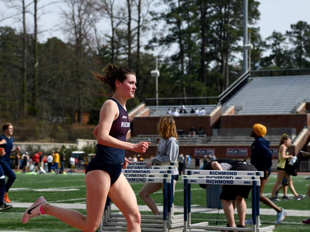 Junior Claire Brown runs the 3000m race.
