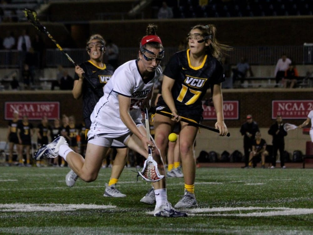 Junior midfielder Katie Sciandra runs to pick up a ground ball.