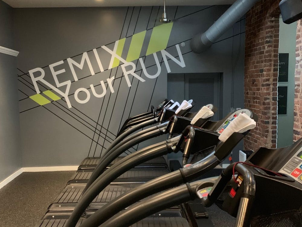 A line of treadmills at Tread Happy, a boutique fitness studio in Richmond's Fan District.
