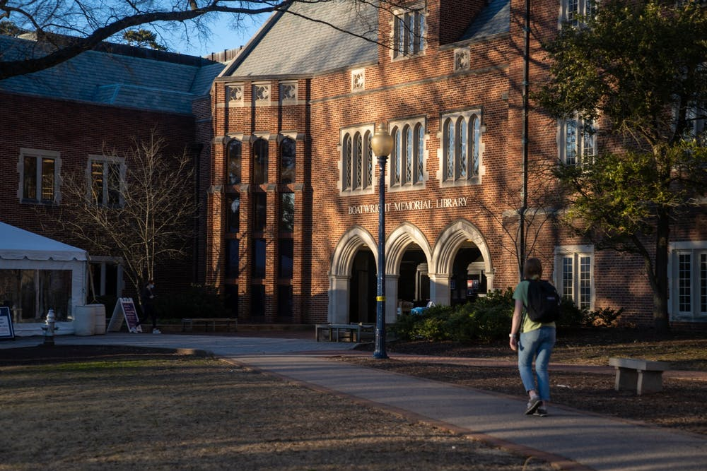 <p>Students march into Boatwright Memorial Library.</p>