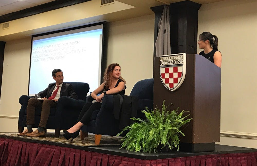 <p>Ned Price, a former CIA agent, sits with Shannon Kane&nbsp;and&nbsp;Jessica Yin at a talk Thursday night.&nbsp;</p>
