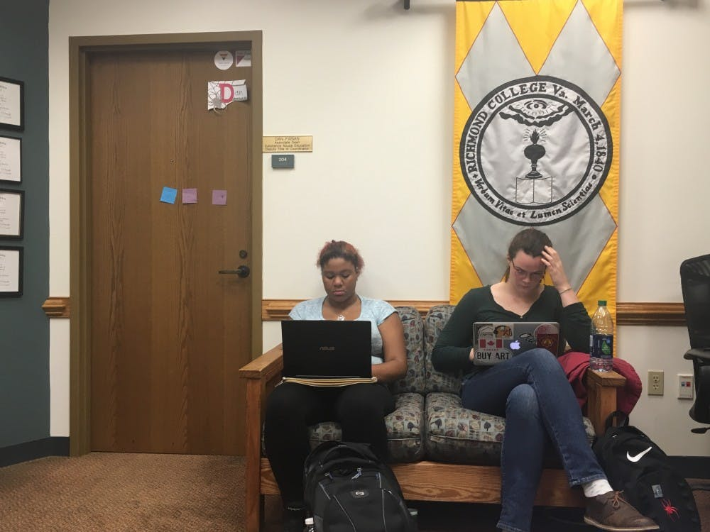 <p>Nia Carter and Rennie Harrison work while waiting for Fabian.</p>