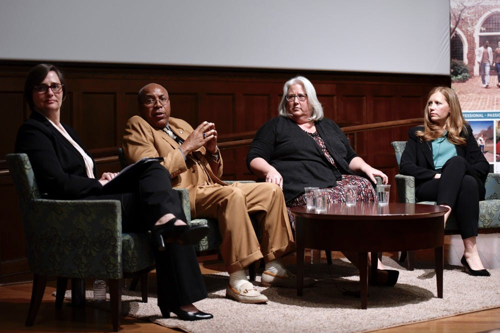 <p>Mary Kelly Tate (left), Thomas Haynesworth, Janet Burke and Shawn Armbrust listen to an audience question during the Conversation on Wrongful Convictions and Reconciliation in Ukrop Auditorium. &nbsp;</p>