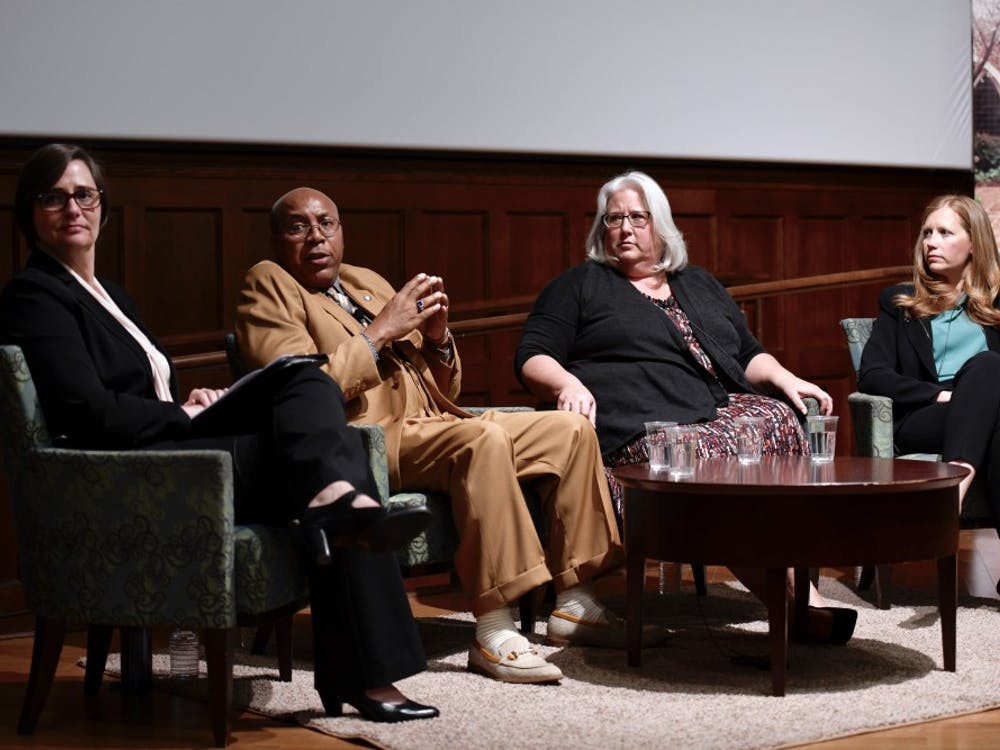 Mary Kelly Tate (left), Thomas Haynesworth, Janet Burke and Shawn Armbrust listen to an audience question during the Conversation on Wrongful Convictions and Reconciliation in Ukrop Auditorium.
