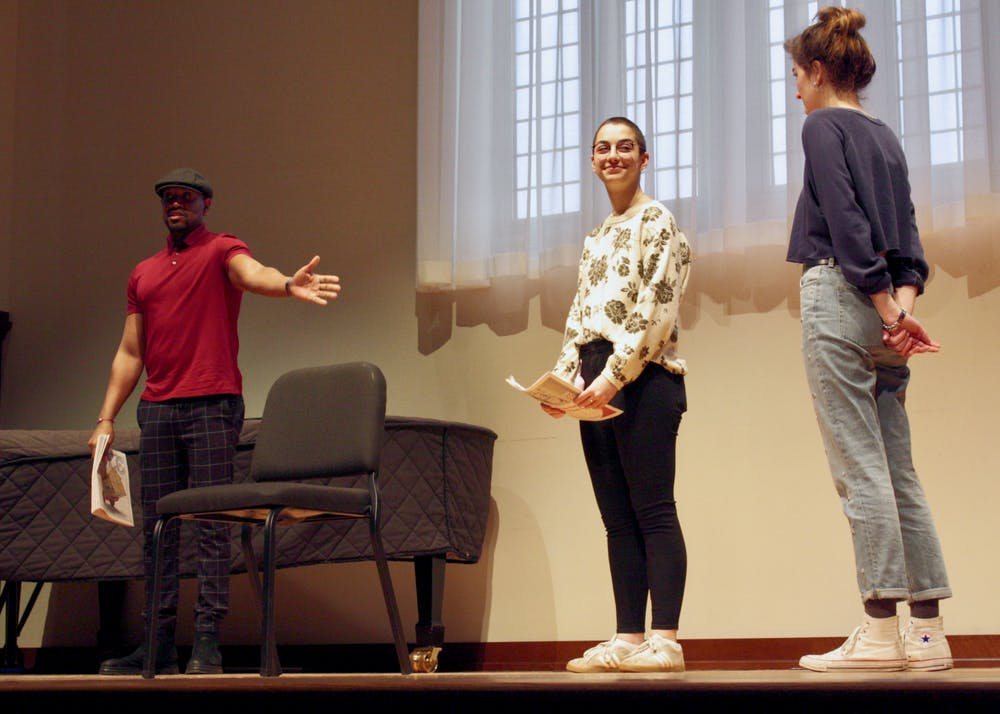 <p>Bryan Terrell Clark coaches theatre students Corrine Manderino and Leslie Gaines in a masterclass on Feb. 6.</p>