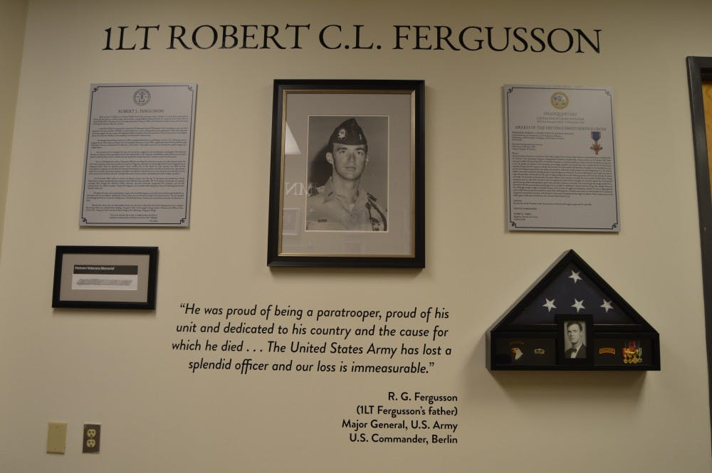 "<p>The dedication wall for Lt. Robert ""Bob"" Fergusson located in the Millheiser Gymnasium.&nbsp;</p>"