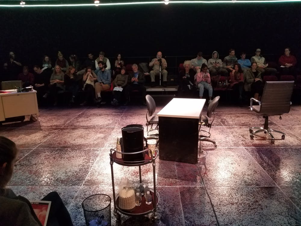 "The view of the stage of ""The Story."" Audience members surrounded the stage on all four sides."