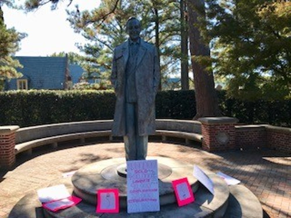 Members of Planned Parenthood Generation Action placed posters on the E.Claiborne Robins statue on October 19, 2017 as part of a demonstration.